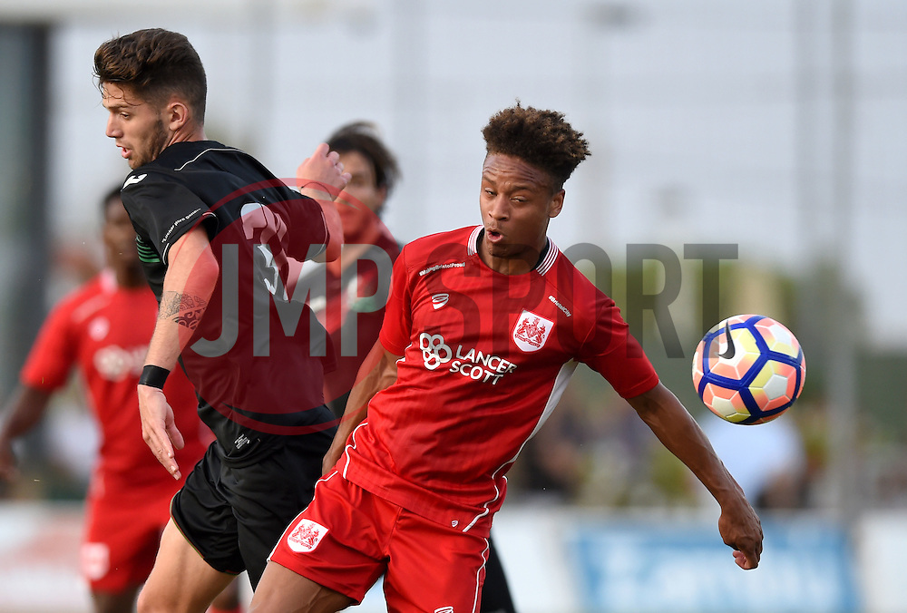 Bobby Reid of Bristol City battles for the high ball with Jean Carlos of Granada  - Mandatory by-line: Joe Meredith/JMP - 20/07/2016 - FOOTBALL - Pinatar Arena - San Pedro del Pinatar, Murcia - Granada v Bristol City - Pre-season friendly