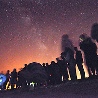 Aug. 2, 2010 -- Andrew Knapp, FLORIDA TODAY -- Biologists and media watch the release of 50 of the 400 sea turtles set free Monday night at Playalinda Beach at Canaveral National Searshore, considered one of the darkest stretches of sand around -- a point illustrated by the Milky Way being visible in the background of this photo. The hatchlings had poked out of their shells earlier Monday after being rescued as eggs from Gulf of Mexico beaches, where it's feared that they'll swim into the BP Deepwater Horizon oil spill. They are brought to an incubation site at Kennedy Space Center, hatched, then released after dark at local beaches.
