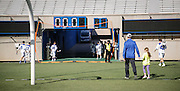 SHOT 2/18/17 2:45:57 PM - Air Force head lacrosse coach Eric Seremet walks off the field with his daughter after losing to Marist College at Falcon Stadium at the Air Force Academy in Colorado Springs, Co. Marist won the game 10-4. Seremet is in his ninth season as the head coach for the Air Force lacrosse program.<br /> (Photo by Marc Piscotty / © 2017)