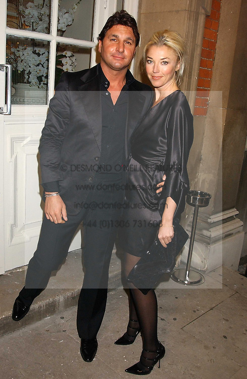 MISS TAMARA BECKWITH and MR GEORGE VERONI at a party to celebrate the Stella McCartney's unique collaboration with fashion store H&M at St.Olavs, Tooley Street, London SE1 on 25th October 2005.<br />