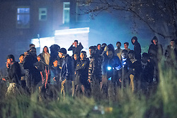 © Licensed to London News Pictures . FILE PICTURE DATED 05/11/2015 . Oldham , UK . A large group of people engaging in anti-social behaviour , shooting fireworks at residences and lighting a bonfire ,  on grass between Stafford Street and Norfolk Street , in Chadderton in Oldham . Oldham has been named England's most deprived town by the Office for National Statistics today (18th March 2016) . Photo credit : Joel Goodman/LNP