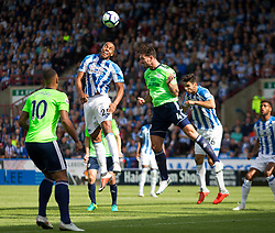 Mathias Zanka Jorgensen of Huddersfield Town and Sean Morrison of Cardiff City (C) go up to head a corner - Mandatory by-line: Jack Phillips/JMP - 25/08/2018 - FOOTBALL - The John Smith's Stadium - Huddersfield, England - Huddersfield Town v Cardiff City - English Premier League