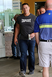 "EXCLUSIVE: WWE Superstar John Cena goes to the premiere of his new movie Blockers accompanied by police and entourage while holding his coffee and showing off his muscles in a tight ""Tapout"" t-shirt. 06 Apr 2018 Pictured: John Cena. Photo credit: MEGA TheMegaAgency.com +1 888 505 6342"