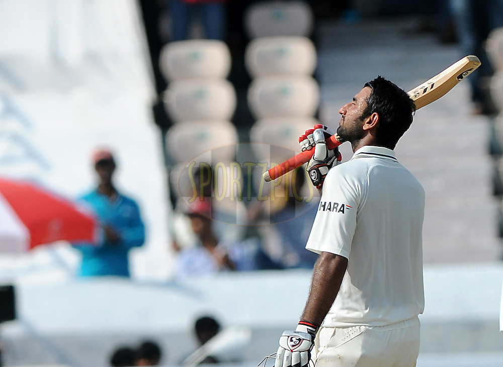 Cheteshwar Pujara of India raise his bat after hitting a century during day one of the first test match between India and New Zealand held at The Rajiv Gandhi International Stadium in Hyderabad, India on the 23rd August 2012..Photo by: Pal Pillai/BCCI/SPORTZPICS
