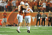 AUSTIN, TX - OCTOBER 18:  Nick Rose #23 of the Texas Longhorns receives a hug from Jaxon Shipley #8 after kicking the game winning 21 yard field goal against the Iowa State Cyclones during the 4th quarter on October 18, 2014 at Darrell K Royal-Texas Memorial Stadium in Austin, Texas.  (Photo by Cooper Neill/Getty Images) *** Local Caption *** Nick Rose; Jaxon Shipley