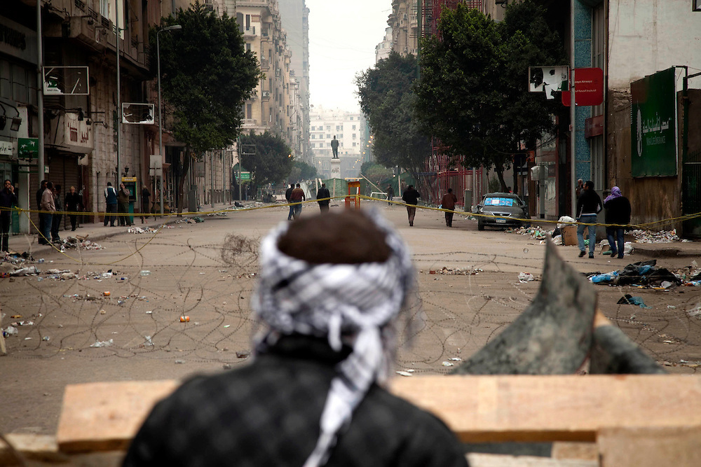 Anti-government protesters gather in Tahrir Square on Saturday, Feb. 5, 2011. The protesters protected themselves from the pro-Mubarak demonstrators with a makeshift barricade, which they defended against the pro-Mubarak crowd.
