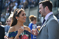 National Hunt Horse Racing - 2019 Randox Health Grand National Festival - Saturday, Day Three (Grand National Day)<br /> <br /> a couple enjoy a drink before the  the 1.45 Gaskells Handicap Hurdle (Grade 3) (Class 1)<br /> at Aintree Racecourse.<br /> <br /> COLORSPORT/WINSTON BYNORTH