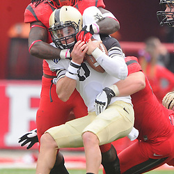 10 November 2012: Rutgers Scarlet Knights linebacker Khaseem Greene (20) wraps up Army Black Knights quarterback Trent Steelman (8) during NCAA college football action between the Rutgers Scarlet Knights and Army Black Knights at High Point Solutions Stadium in Piscataway, N.J..