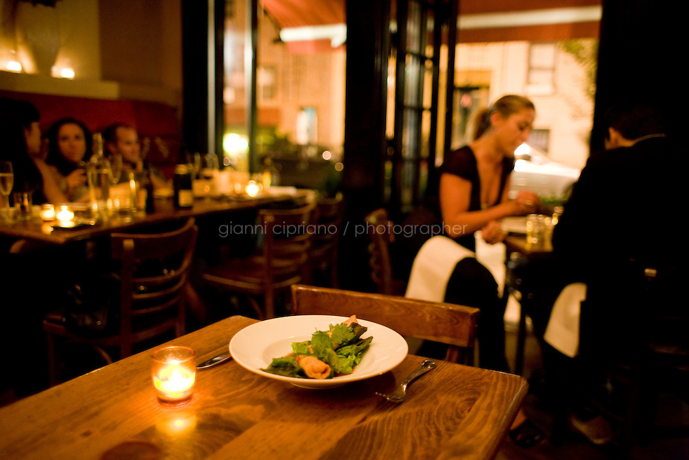 9 October, 2008. New York, NY. A dish of spring rolls is here on a table, while customers in the background have late dinner after midnight at Shorty's 32 Restaurant in Soho. Shorty's 32 has late night services some nights. <br /> <br /> ©2008 Gianni Cipriano for The New York Times<br /> cell. +1 646 465 2168 (USA)<br /> cell. +1 328 567 7923 (Italy)<br /> gianni@giannicipriano.com<br /> www.giannicipriano.com