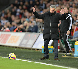 Chelsea Manager, Jose Mourinho puts his arms i the air. - Photo mandatory by-line: Alex James/JMP - Mobile: 07966 386802 - 17/01/2015 - SPORT - football - Swansea - Liberty Stadium  - Swansea  v Chelsea  -