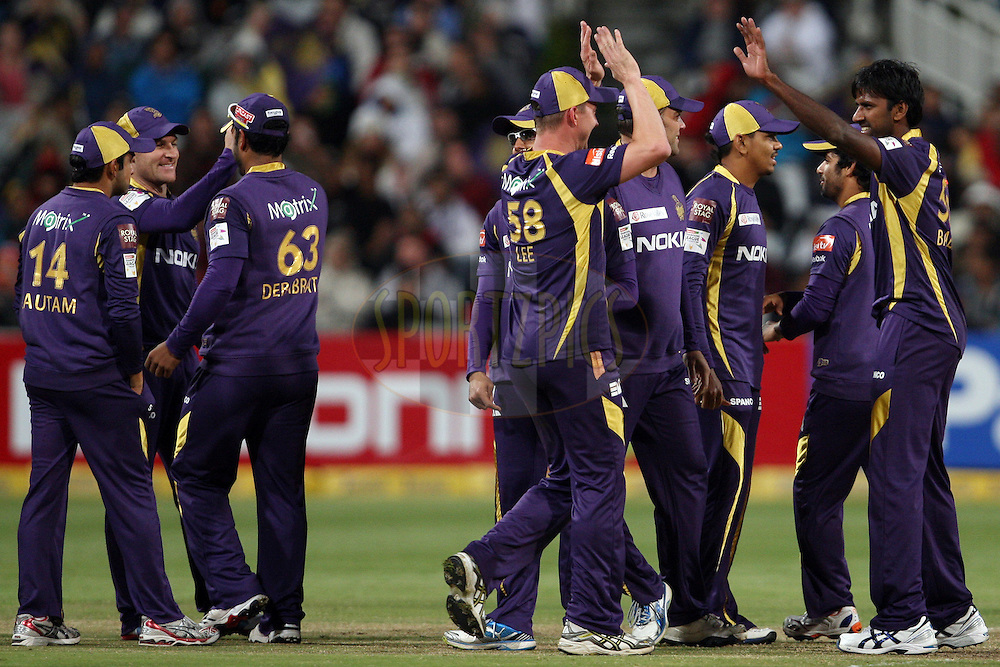 KKR players celebrate a wicket during match 16 of the Karbonn Smart CLT20 South Africa between The Kolkata Knight Riders and the Titans held at Newlands Stadium in Cape Town, South Africa on the 21st October 2012. Photo by Jacques Rossouw/SPORTZPICS/CLT20