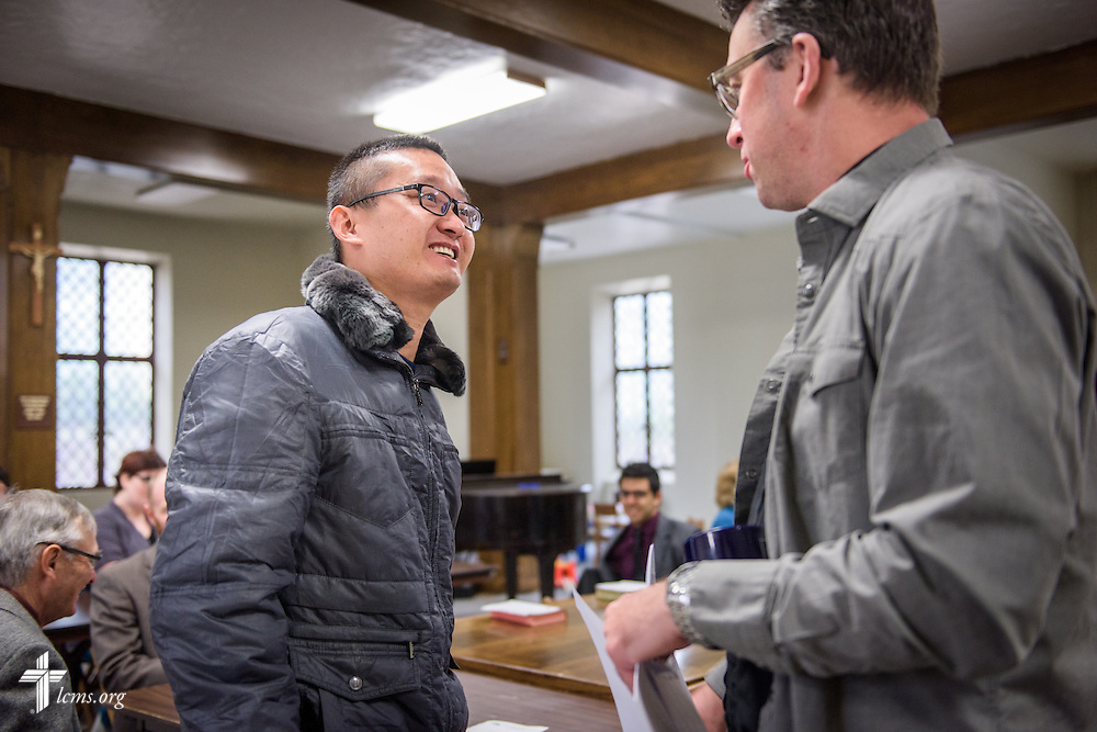 The Rev. Eric R. Andræ talks with Hongshun Yang before worship at First Trinity Evangelical–Lutheran Church on Sunday, Nov. 20, 2016, in Pittsburgh. LCMS Communications/Erik M. Lunsford