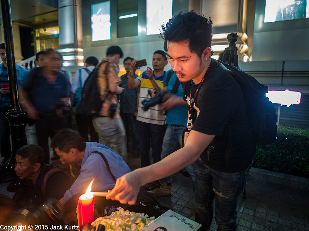 18 AUGUST 2015 - BANGKOK, THAILAND: A man prays at a makeshift memorial in front of Erawan Shrine, which was damaged by a bomb Monday night. An explosion at Erawan Shrine, a popular tourist attraction and important religious shrine in the heart of the Bangkok shopping district, killed at least 20 people and injured more than 120 others, including foreign tourists, during the Monday evening rush hour. Twelve of the dead were killed at the scene. Thai police said an Improvised Explosive Device (IED) was detonated at 18.55. Police said the bomb was made of more than six pounds of explosives stuffed in a pipe and wrapped with white cloth. Its destructive radius was estimated at 100 meters.    PHOTO BY JACK KURTZ    PHOTO BY JACK KURTZ