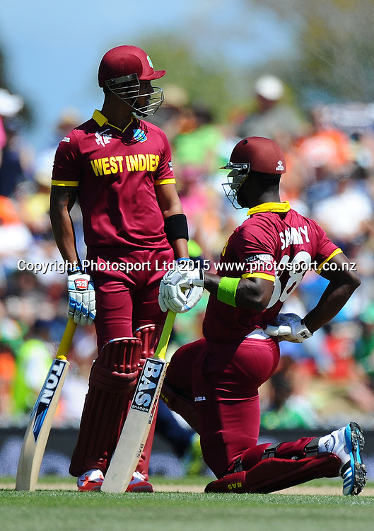 West Indies player Darren Sammy rubs his sore back  during the 2015 ICC Cricket World Cup match between West Indies and Ireland. Saxton Oval, Nelson, New Zealand. Monday 16 February 2015. Copyright Photo: Chris Symes / www.photosport.co.nz