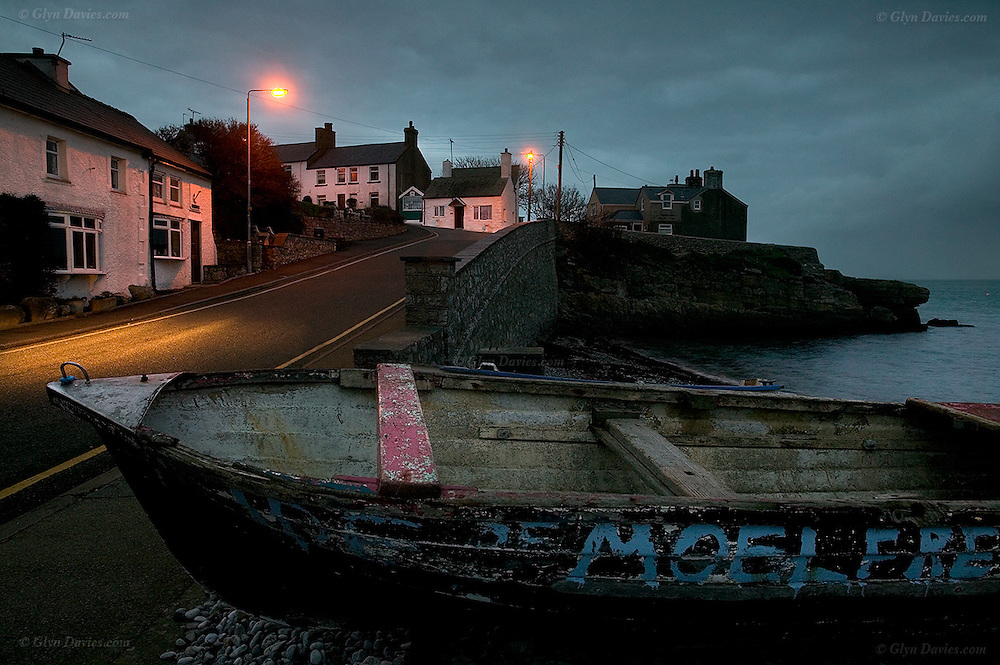 The pretty coastal centre of the fishing, now tourist village of Moelfre, East Anglesey at dusk.