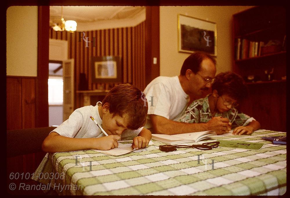 Zel Bodulovic, Yugoslavian immigrant, tutors sons each morning at home before school; Wagga, NSW. Australia