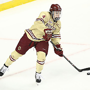 Teddy Doherty #4 of the Boston College Eagles looks to pass the puck during The Beanpot Championship Game at TD Garden on February 10, 2014 in Boston, Massachusetts. (Photo by Elan Kawesch)