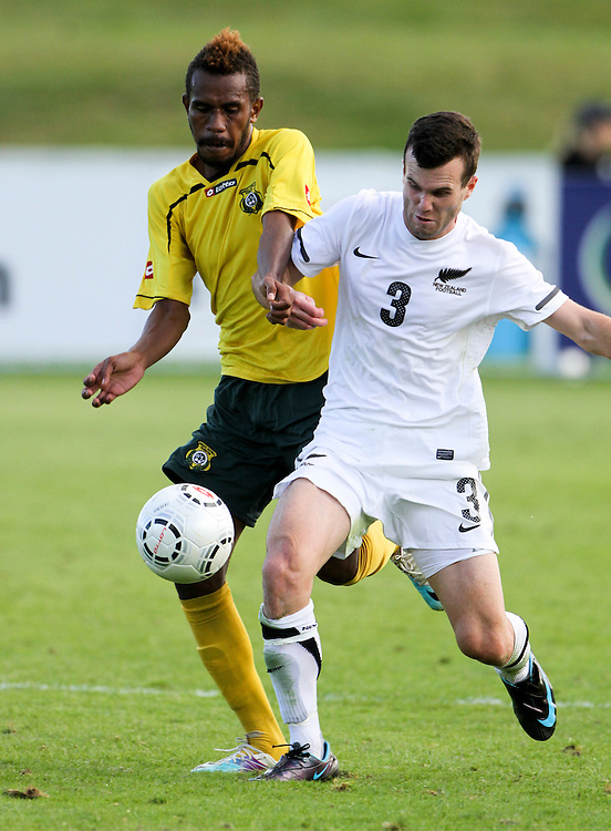 New Zealand's Ian Hogg challenges Vanuatu's Barry Mansale in the teams OFC Mens Olympic qualifier semi final football match, Owen Delany Park, Taupo, New Zealand, Friday, March 23, 2012. Credit:SNPA / John Cowpland