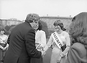 An Taoiseach Meets The Roses Of Tralee.  (N90)..1981..28.08.1981..08.28.1981..28th August 1981..An Taoiseach, Garret Fitzgerald, met with the contestants of The Rose Of Tralee Festival when they were invited to Government Buildings, Leinster House, Dublin...Image of An Taoiseach, Garret Fitzgerald,as he  meets and greets the Waterford Rose,Marian Ryan, in the gardens of government buildings.