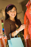 Young woman in clothes shop (portrait)