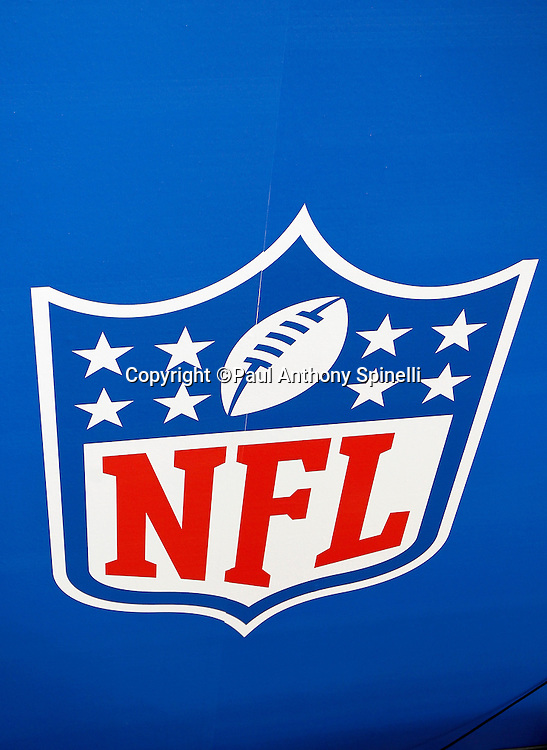 An NFL shield logo decorates a sideline banner as the AFC Pittsburgh Steelers speak to the press at Super Bowl XLV media day prior to NFL Super Bowl XLV against the Green Bay Packers. Media day was held on Tuesday, February 1, 2011 in Arlington, Texas. ©Paul Anthony Spinelli