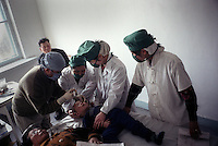 North Korea Eye Surgery Workshop. North Korean nurses assist in preparing a boy for his cataract operation. Most children contract cataracts through congential reasons, some times through trauma.