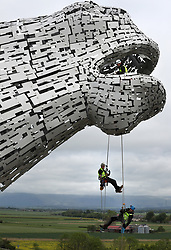 Embargoed to 0001 Monday May 29 Rope Access Technicians Andrew Pennycuick (bottom), Paul Smith (centre) and John Benson carry out the first health check on the Kelpies in Falkirk as they approach their third birthday.