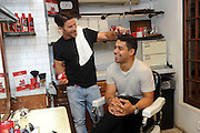 Actor Wilmer Valderrama and celebrity groomer Benjamin Thigpen partner with Old Spice Hair to help guys take the guessing game out of hair styling and educate them on the brand's lineup of Pomade, Putty and Paste stylers, Thursday, July 7, 2016 at Sharps Barber and Shop, Le Parker Meridien, in New York. (Diane Bondareff/AP Images for Old Spice)