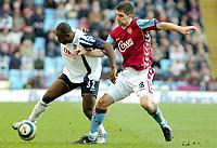 Photo: Ed Godden.<br />Aston Villa v Portsmouth. The Barclays Premiership. 04/03/2006. Lomana Lua Lua (L) and Villa's Aaron Hughes tussle for the ball.