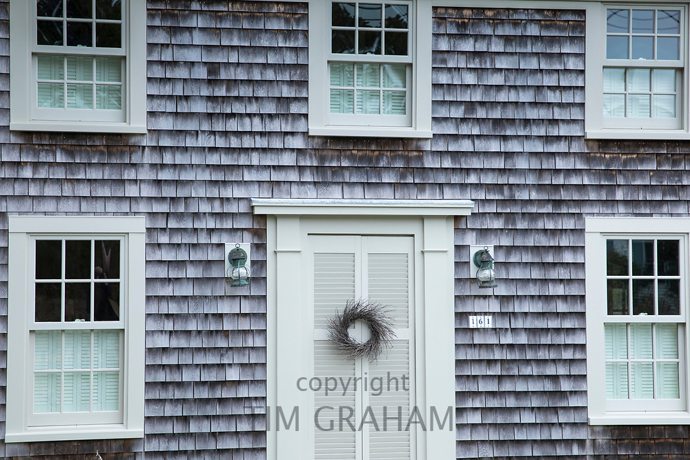 Traditional wood shingle timber architecture of house by Cockle Cove at Chatham, Cape Cod, New England, USA