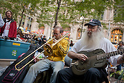 Singer and guitarist Dennis Gronin plays a steel guitar alongside a trombone player. Gronin has been involved in protests since the 60s.