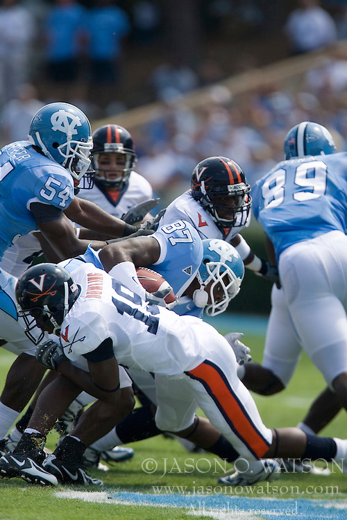 Virginia wide receiver Ras-I Dowling (19) tackles North Carolina wide receiver Brandon Tate (87)..The North Carolina Tar Heels football team faced the Virginia Cavaliers at Kenan Memorial Stadium in Chapel Hill, NC on September 15, 2007.  UVA defeated UNC 22-20.