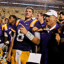 September 10, 2011; Baton Rouge, LA, USA;  LSU Tigers quarterback Zach Mettenberger (8) and head coach Les Miles sing together with teammates following a win over the Northwestern State Demons at Tiger Stadium. LSU defeat Northwestern State 49-3. Mandatory Credit: Derick E. Hingle