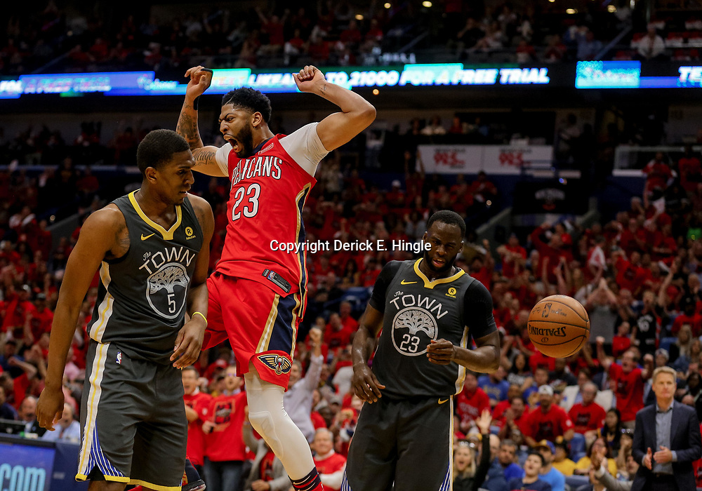 May 4, 2018; New Orleans, LA, USA; New Orleans Pelicans forward Anthony Davis (23) dunks over the Golden State Warriors forward Draymond Green (23)  and forward Kevon Looney (5) during the third quarter in game three of the second round of the 2018 NBA Playoffs at Smoothie King Center. Mandatory Credit: Derick E. Hingle-USA TODAY Sports