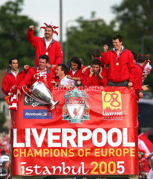 LIVERPOOL, ENGLAND - THURSDAY, MAY 26th, 2005: Liverpool players Luis Garcia, Jamie Carragher, Jerzy Dudek, Steve Finnan, Dietmar Hamann, Milan Baros, Igor Biscan, Steven Gerrard and John Arne Riise parade the European Champions Cup on on open-top bus tour of Liverpool in front of 500,000 fans after beating AC Milan in the UEFA Champions League Final at the Ataturk Olympic Stadium, Istanbul. (Pic by David Rawcliffe/Propaganda)