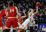 South Dakota State's Madison Guebert (11) dives for a layup through the University of South Dakota defense during a game at Frost Arena in Brookings. (Matt Gade / Republic)