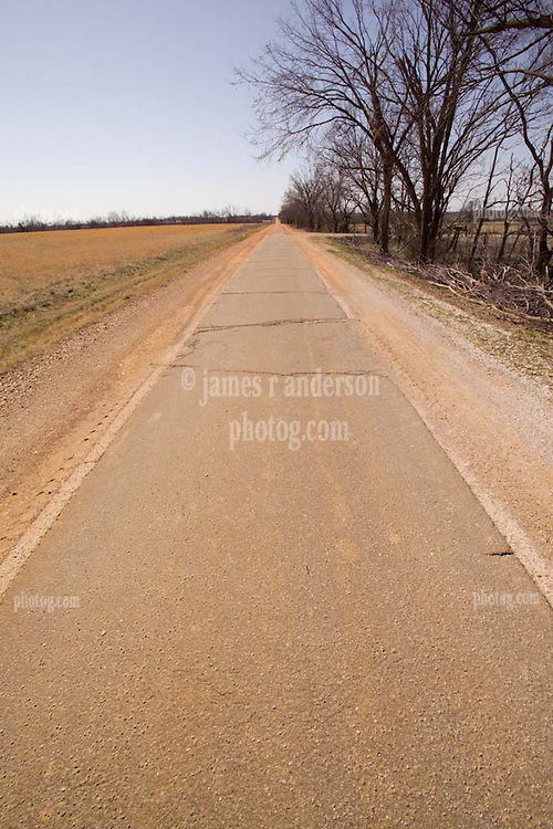 """Old US Route 66 south of Miami Oklahoma. Original alignment consisting of Portland Cement just 8 feet wide here, sometimes refered to as """"Sidewalk Highway"""""""