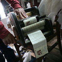 SETTLER'S BOUTIQUE WINE 2009...A hand made sticking labels machine at Tanya boutique winery in the West Bank Jewish settlement of Ofra, December 2009.