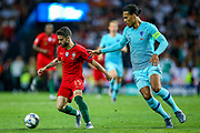 Portugal midfielder Rafa Silva (15) battles with Netherlands Defender Virgil van Dijk (Liverpool) during the UEFA Nations League match between Portugal and Netherlands at Estadio do Dragao, Porto, Portugal on 9 June 2019.