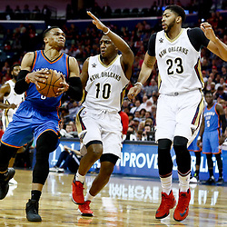 Jan 25, 2017; New Orleans, LA, USA; Oklahoma City Thunder guard Russell Westbrook (0) drives past New Orleans Pelicans guard Langston Galloway (10) and forward Anthony Davis (23) during the second quarter of a game at the Smoothie King Center. Mandatory Credit: Derick E. Hingle-USA TODAY Sports