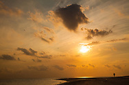 A lone person, walking on the beach, is silhouetted by the morning sun, Zanzibar, Tanzania. http://www.gettyimages.com/detail/photo/skys-the-limit-royalty-free-image/481202105