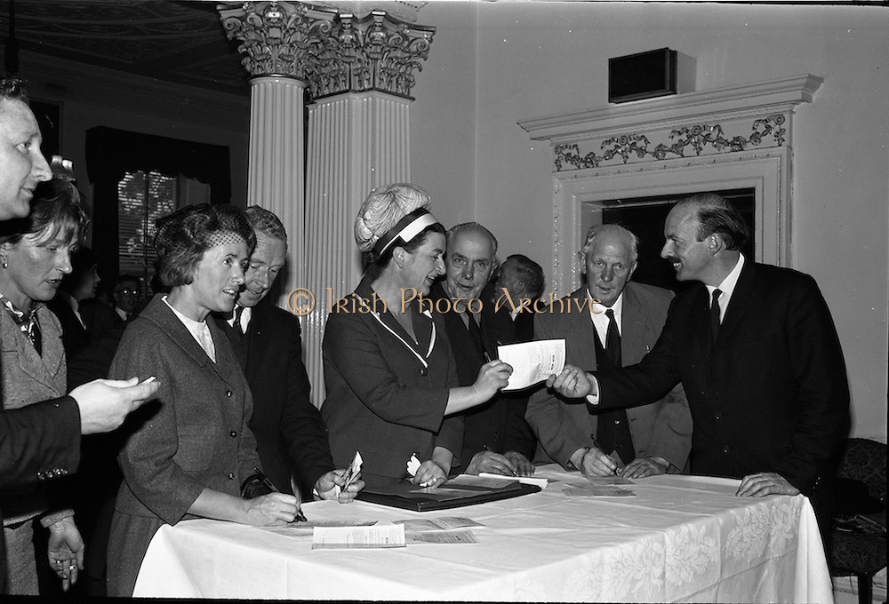 01/06/1964<br /> 06/01/1964<br /> 01 June 1964<br /> Language Organisations reception at the Shelbourne Hotel, Dublin for signing of declaration regarding the future of the Irish language. Among the leading personalities gathered to sign the National Declaration regarding the future of the Irish Language were Mrs. Dorothy Tubridy; Proinnsios Moc a'Bheatha, (Glun na Bua); Miss Neilli Mulcahy (Fashion designer); Captain Tom Scully, F.A.I.; Mr. Joe Wyckham, (National Secretary F.A.I.) and Domhnall O'Morain, Chairman Gael Linn.