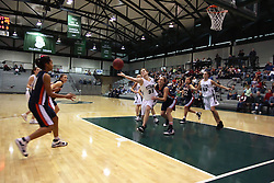 10 January 2009: Colleen Caplice can't quite reel in a loose ball. The Lady Titans of Illinois Wesleyan University downed the and Lady Thunder of Wheaton College by a score of 101 - 57 in the Shirk Center on the Illinois Wesleyan Campus in Bloomington Illinois.