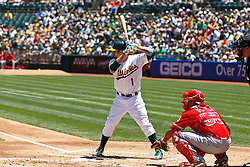 OAKLAND, CA - JUNE 21:  Billy Burns #1 of the Oakland Athletics at bat against the Los Angeles Angels of Anaheim during the first inning at O.co Coliseum on June 21, 2015 in Oakland, California. The Oakland Athletics defeated the Los Angeles Angels of Anaheim 3-2. (Photo by Jason O. Watson/Getty Images) *** Local Caption *** Billy Burns