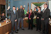Laconia Police Officers Joseph Tucker, Joel Hernandez, Megan DeNute, Anna Croteau and Bryan Moynihan being sworn in by Ann Kaligian Thursday afternoon at Laconia City Hall.  (Karen Bobotas/for the Laconia Daily Sun)