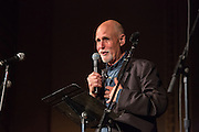 John Platt, radio host at WFUV, on stage at the Folk City benefit concert at the Museum of the City of New York. The concert was held to support a forthcoming exhibit on the folk msusic revival in New York in the 1950s and 60s.