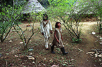 Kogi Indian boys walk through the village coca field in the Sierra Nevada Mountains, on Colombia?s Caribbean coast in 2004. The Indians in the Sierra Nevada grow and chew coca as part of their culture and tradition. (Photo/Scott Dalton)