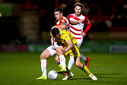 Ollie Clarke of Bristol Rovers takes on Tommy Rowe of Doncaster Rovers - Mandatory by-line: Robbie Stephenson/JMP - 26/03/2019 - FOOTBALL - Keepmoat Stadium - Doncaster, England - Doncaster Rovers v Bristol Rovers - Sky Bet League One