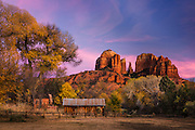 The towering buttes of Cathedral Rock rise above the fall color at Crescent Moon Ranch in Sedona, Arizona.