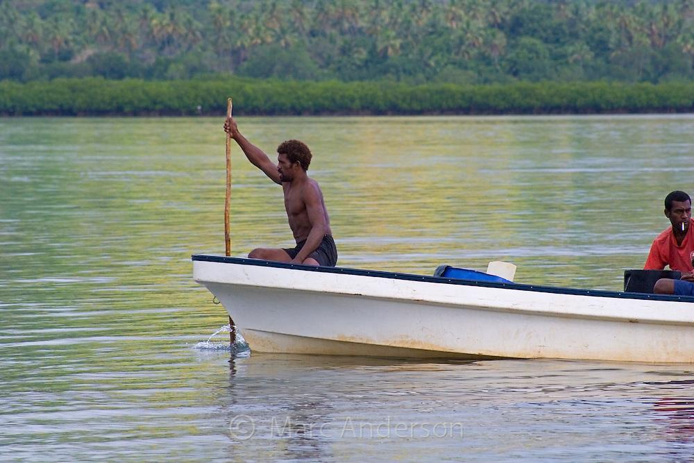 A Fijian man in a small boat in Vanua Levu, Fiji.